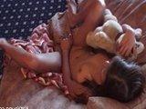 Юна азиатская девочка нежно ласкает пальчиками плотную киску